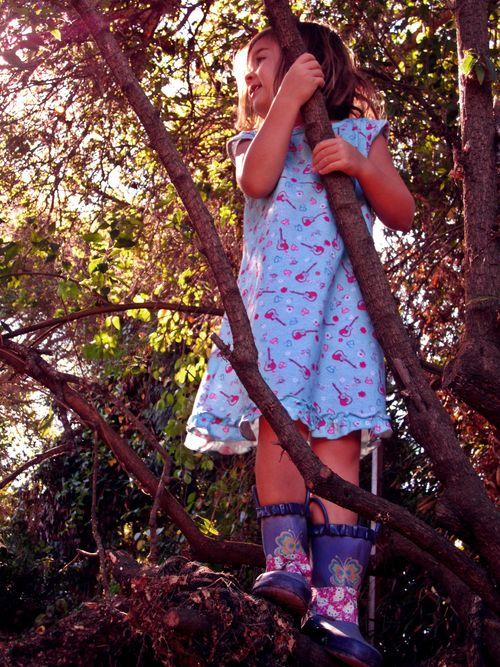 Tree climbing in rain boots and a nightgown